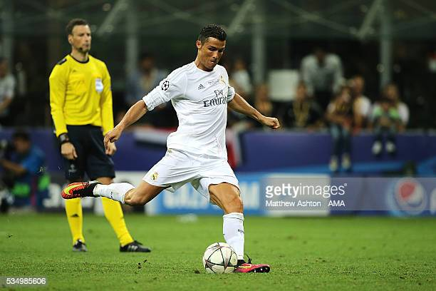 Cristiano Ronaldo of Real Madrid scores the winning penalty in a shootout during the UEFA Champions League final match between Real Madrid and Club...