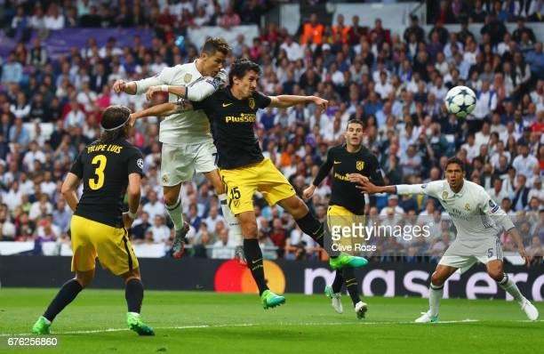 Cristiano Ronaldo of Real Madrid scores their first goal during the UEFA Champions League semi final first leg match between Real Madrid CF and Club...