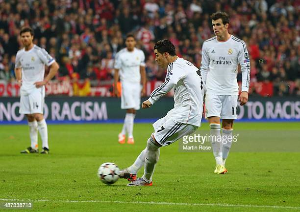 Cristiano Ronaldo of Real Madrid scores their fourth goal from a free kick during the UEFA Champions League semifinal second leg match between FC...