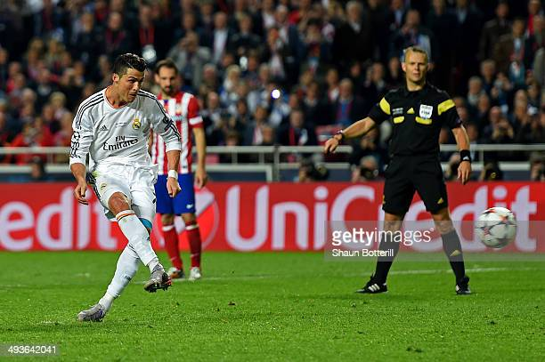 Cristiano Ronaldo of Real Madrid scores their fourth goal from penalty spot during the UEFA Champions League Final between Real Madrid and Atletico...