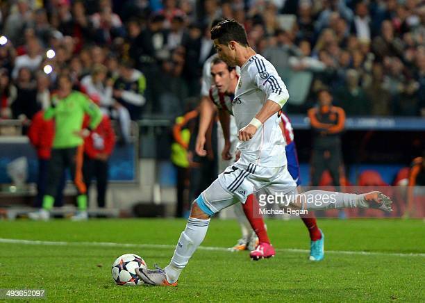 Cristiano Ronaldo of Real Madrid scores their fourth goal from the penalty spot during the UEFA Champions League Final between Real Madrid and...