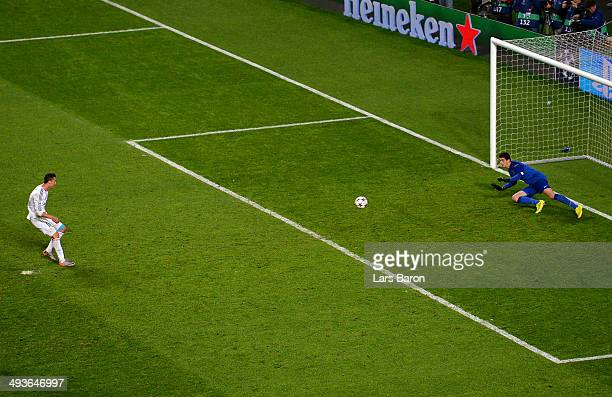 Cristiano Ronaldo of Real Madrid scores their fourth goal past Thibaut Courtois of Club Atletico de Madrid from the penalty spot during the UEFA...