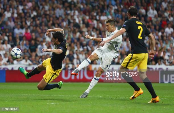 Cristiano Ronaldo of Real Madrid scores their second goal during the UEFA Champions League semi final first leg match between Real Madrid CF and Club...