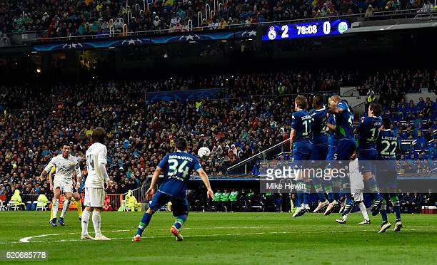 Cristiano Ronaldo of Real Madrid scores their their goal from a free kick and completes his hat trick during the UEFA Champions League quarter final...