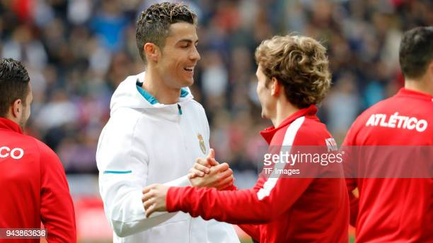 Cristiano Ronaldo of Real Madrid shakes hands with Antoine Griezmann of Atletico Madrid during the La Liga match between Real Madrid and Atletico...