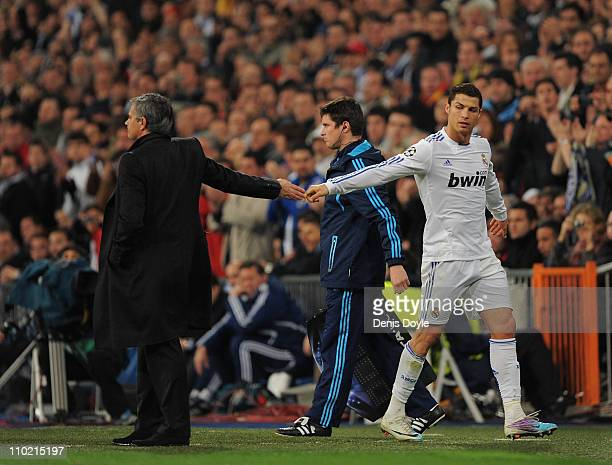 Cristiano Ronaldo of Real Madrid shakes hands with head coach Jose Mourinho after being substituted during the UEFA Champions League round of 16...