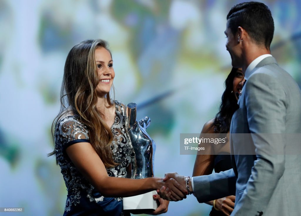 Cristiano Ronaldo of Real Madrid shakes hands with Lieke Martens of Barcelona during the UEFA Champions League Group stage draw ceremony, at the Grimaldi Forum, Monte Carlo in Monaco, on August 24, 2017.