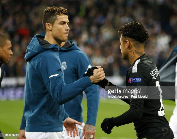 Cristiano Ronaldo of Real Madrid shakes hands with Neymar of Paris SaintGermain before the UEFA Champions League Round of 16 First Leg match between...