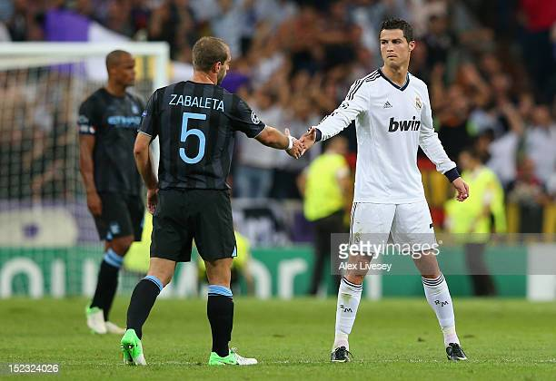 Cristiano Ronaldo of Real Madrid shakes hands with Pablo Zabaleta of Manchester City FC after the UEFA Champions League Group D match between Real...