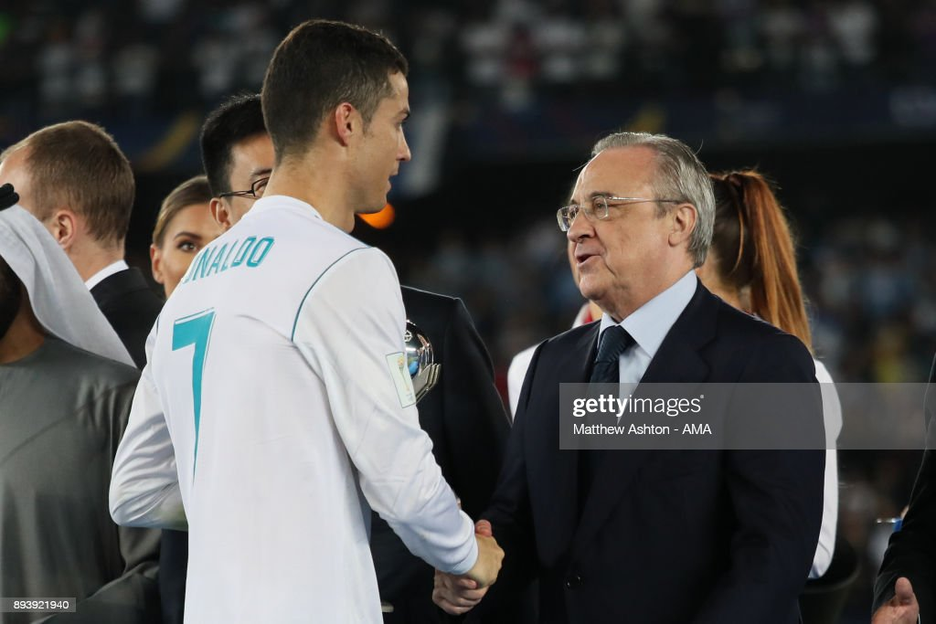 Cristiano Ronaldo of Real Madrid shakes hands with Real Madrid President Florentino Perez at the end of the FIFA Club World Cup UAE 2017 final match between Gremio and Real Madrid CF at Zayed Sports City Stadium on December 16, 2017 in Abu Dhabi, United Arab Emirates.