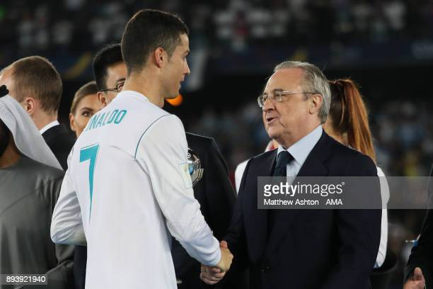 Cristiano Ronaldo of Real Madrid shakes hands with Real Madrid President Florentino Perez at the end of the FIFA Club World Cup UAE 2017 final match...