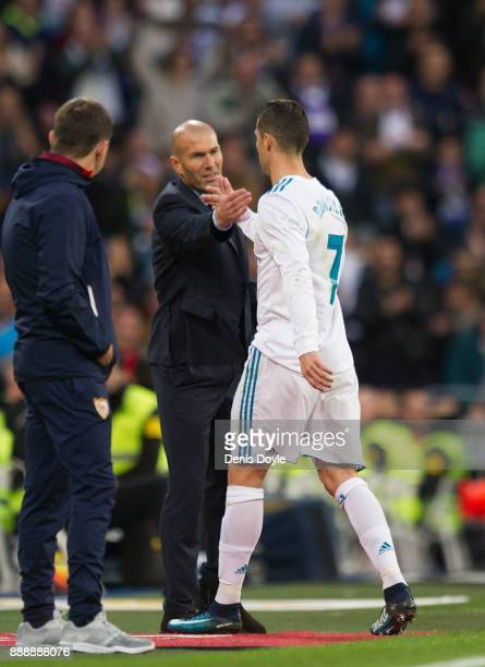 Cristiano Ronaldo of Real Madrid shakes hands with Zinedine Zidane Manager of Real Madrid after being substituted during the La Liga match between...