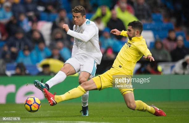 Cristiano Ronaldo of Real Madrid shoots at goal past Alvaro Gonzalez of Villarreal CF during the La Liga match between Real Madrid and Villarreal at...