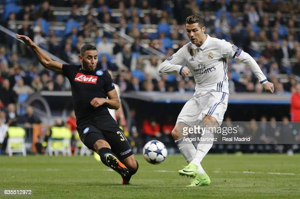 Cristiano Ronaldo of Real Madrid shoots on goal past Faouzi Ghoulam of SSC Napoli during the UEFA Champions League Round of 16 first leg match...