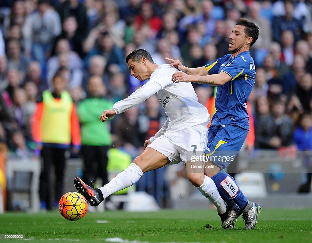 Cristiano Ronaldo of Real Madrid shoots past Roberto Lago of Getafe to score his team's 4th goal during the La Liga match between Real Madrid CF and Getafe CF at Estadio Santiago Bernabeu on December 5, 2015 in Madrid, Spain.