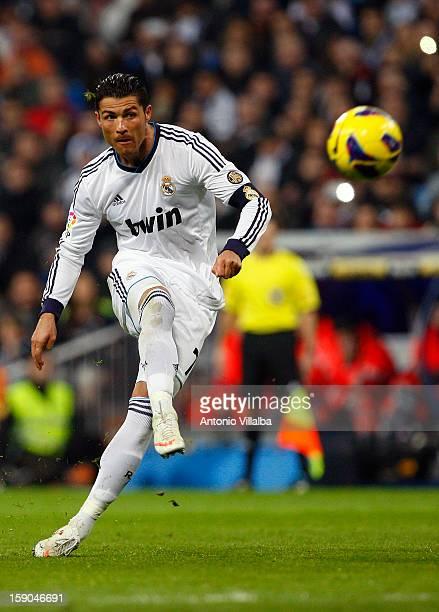 Cristiano Ronaldo of Real Madrid shoots the ball during the La Liga match between Real Madrid and Real Sociedad at Estadio Santiago Bernabeu on...