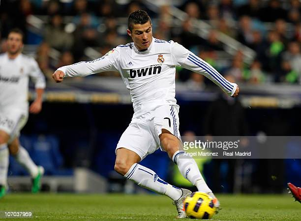 Cristiano Ronaldo of Real Madrid shoots to score Real's 20 goal during the La Liga match between Real Madrid and Athletic Bilbao at Estadio Santiago...
