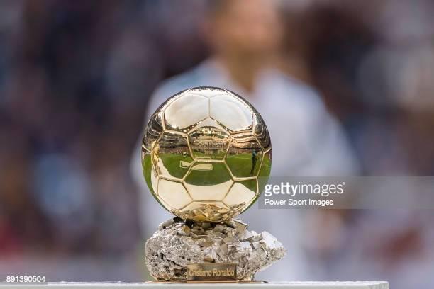 Cristiano Ronaldo of Real Madrid shows his FIFA Ballon Dor Trophies during the La Liga 201718 match between Real Madrid and Sevilla FC at Santiago...