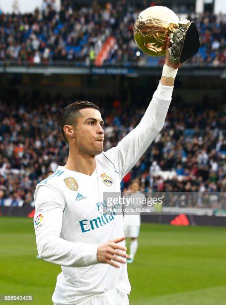 Cristiano Ronaldo of Real Madrid shows his recent won Golden Ball trophy prior to start the La Liga match between Real Madrid and Sevilla at Estadio...