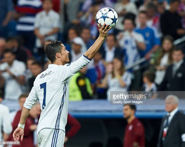 Cristiano Ronaldo of Real Madrid shows the ball after scoring a hattrick during the UEFA Champions League Quarter Final second leg match between Real...