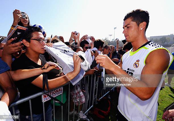 Cristiano Ronaldo of Real Madrid signs a soccer shirt after participating in the Adidas training with local youth soccer player August 5 2010 in...