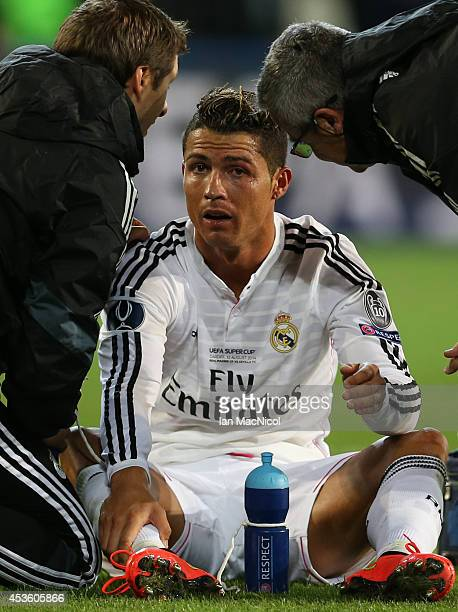 Cristiano Ronaldo of Real Madrid sits injured during the UEFA Super Cup match between Real Madrid and Sevilla at Cardiff City Stadium on August 12...