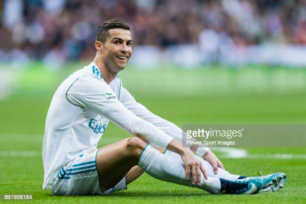 Cristiano Ronaldo of Real Madrid sits on the pitch during the La Liga 201718 match between Real Madrid and Sevilla FC at Santiago Bernabeu Stadium on...