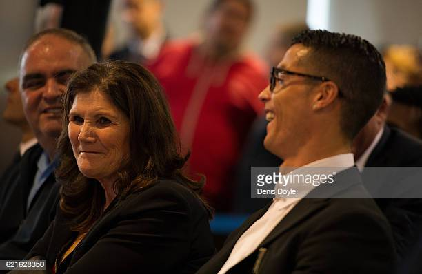 Cristiano Ronaldo of Real Madrid smiles with his mother Maria Dolores dos Santos Aveiro while they watch highlights of his favourite goals on a video...