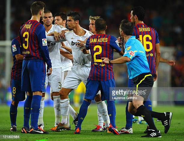 Cristiano Ronaldo of Real Madrid squares up to Andres Iniesta of Barcelona during the second goal during the Super Cup second leg match between...