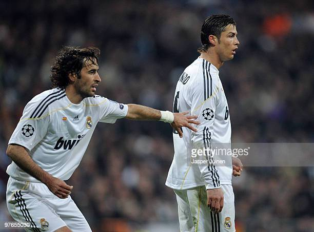 Cristiano Ronaldo of Real Madrid stands flanked by Raul Gonzalez during the UEFA Champions League round of 16 second leg match between Real Madrid...