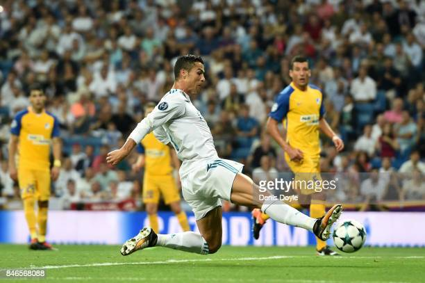Cristiano Ronaldo of Real Madrid stretches for the ball during the UEFA Champions League group H match between Real Madrid and APOEL Nikosia at...