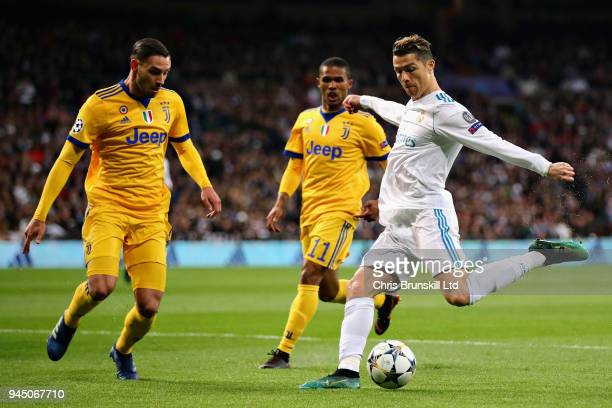 Cristiano Ronaldo of Real Madrid takes a shot as Mattia De Sciglio of Juventus attempts to block during the UEFA Champions League Quarter Final...