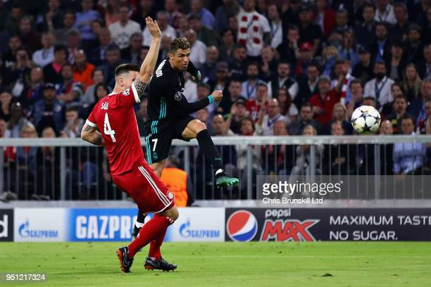 Cristiano Ronaldo of Real Madrid takes a shot during the UEFA Champions League Semi Final First Leg match between Bayern Muenchen and Real Madrid at...