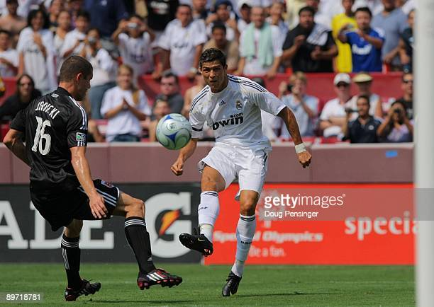 Cristiano Ronaldo of Real Madrid takes a shot off the post past Greg Janicki of DC United during the friendly match at FedExField on August 9 2009 in...