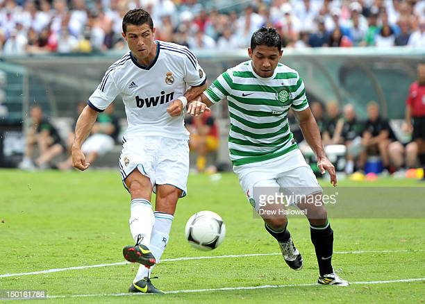Cristiano Ronaldo of Real Madrid takes a shot past defender Emilio Izaguirre of Celtic at Lincoln Financial Field on August 11, 2012 in Philadelphia,...
