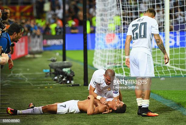 Cristiano Ronaldo of Real Madrid takes off his shirt in celebration after scoring the winning penalty in the penalty shoot out during the UEFA...