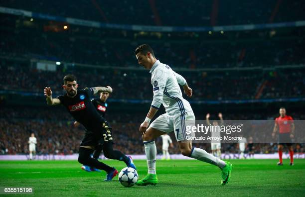Cristiano Ronaldo of Real Madrid takes on Elseid Hysaj of Napoli during the UEFA Champions League Round of 16 first leg match between Real Madrid CF...
