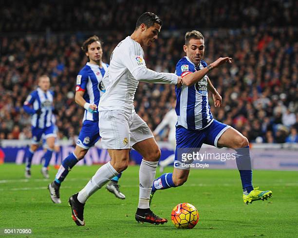 Cristiano Ronaldo of Real Madrid takes on Fernando Navarro of Deportivo La Coruna during the La Liga match between Real Madrid CF and RC Deportivo La...