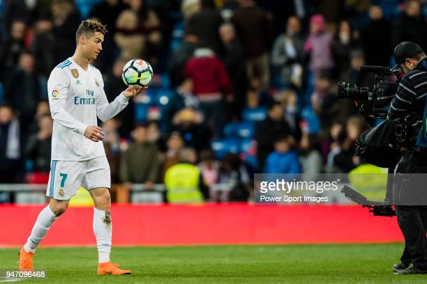 Cristiano Ronaldo of Real Madrid takes the ball at the end of the La Liga 201718 match between Real Madrid and Girona FC at Estadio Santiago Bernabéu...