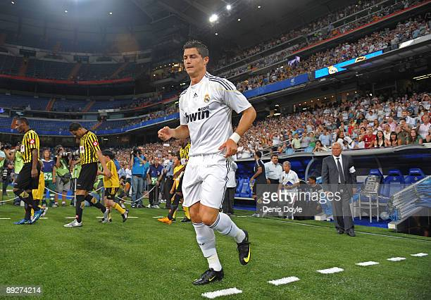 Cristiano Ronaldo of Real Madrid takes to the field for his debut home match at the Santiago Bernabeu stadium during the Peace Cup match between Real...
