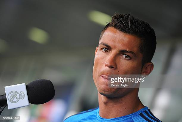 Cristiano Ronaldo of Real Madrid talks to members of the press at the mixed zone after the team training session at the Real Madrid Open Media Day...