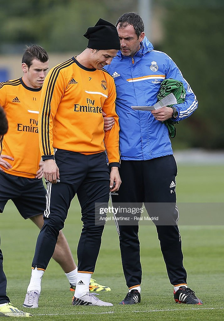 Cristiano Ronaldo (L) of Real Madrid talks with assistant coach Paul Clement during a training session ahead of their El Clasico match against Barcelona at Valdebebas training ground on March 22, 2014 in Madrid, Spain.