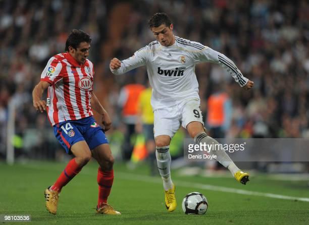 Cristiano Ronaldo of Real Madrid tries to beat Salvio of Atletico Madrid during the La Liga match between Real Madrid and Atletico Madrid at Estadio...