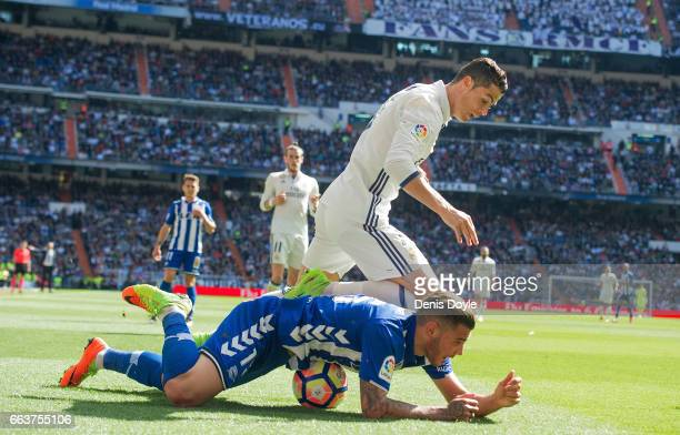Cristiano Ronaldo of Real Madrid tries to grt thr ball from under Theo Hernandez of Deportivo Alaves during the La Liga match between Real Madrid CF...