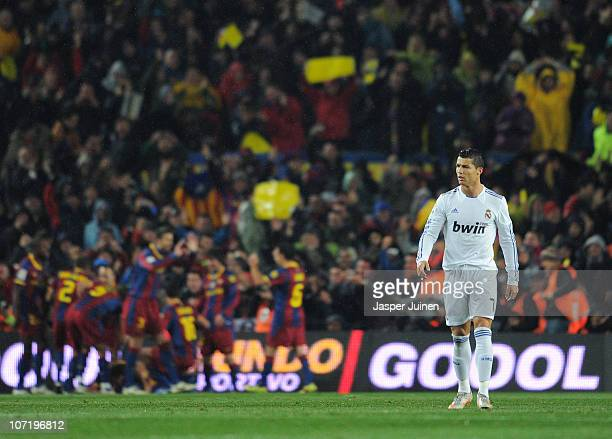 Cristiano Ronaldo of Real Madrid trudges back to the half wayline after Barcelona scored their second goal during the la liga match between Barcelona...