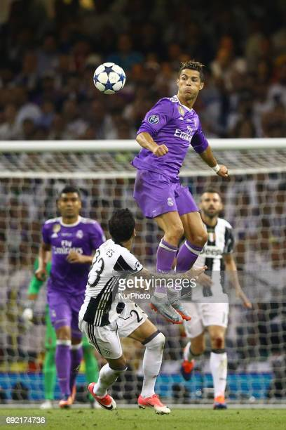 Cristiano Ronaldo of Real Madrid vies Daniel Alves of Juventus during the UEFA Champions League Final between Juventus and Real Madrid at National...