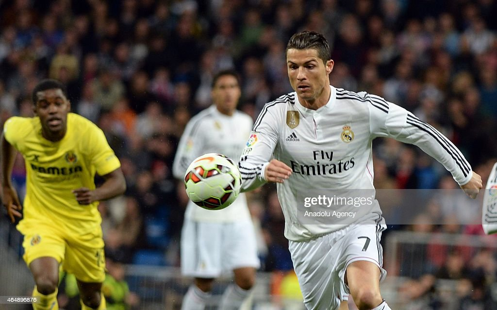 Cristiano Ronaldo of Real Madrid (L) vies with Campell of Villarreal (L) during the La Liga match between Real Madrid and Villarreal at Estadio Santiago Bernabeu in Madrid, Spain on March 1, 2015.