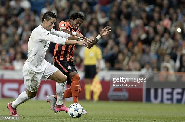 Cristiano Ronaldo of Real Madrid vies with Fred of Shakhtar Donetsk during the UEFA Champions League Group A football match between Real Madrid and...