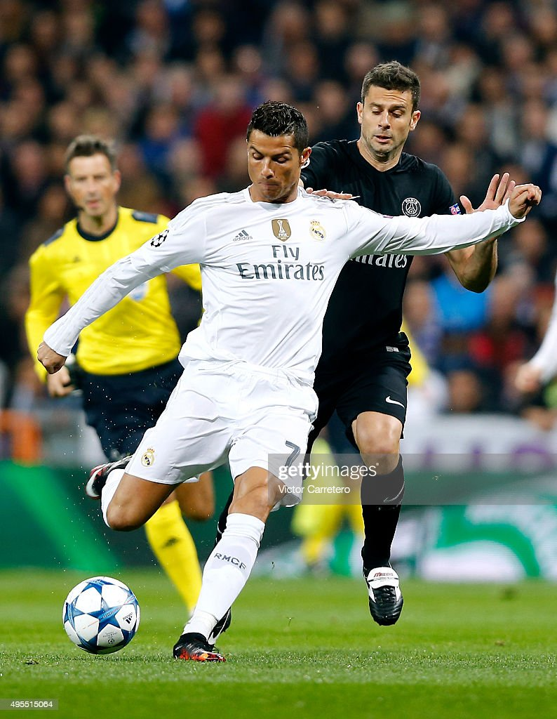 Cristiano Ronaldo of Real Madrid vies with Thiago Motta of Paris Saint-Germain during the UEFA Champions League Group A match between Real Madrid and Paris Saint-Germain at Estadio Santiago Bernabeu on November 3, 2015 in Madrid, Spain.