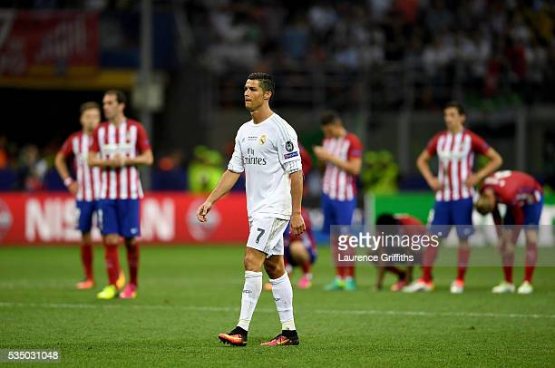 Cristiano Ronaldo of Real Madrid wakls to the penalty spot before scoring the winning penalty in the penalty shoot out during the UEFA Champions...